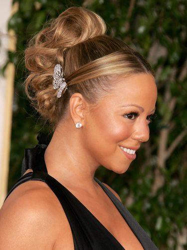 Mariah Carey con un peinado de rulos