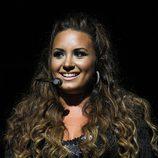 Demi Lovato con melena XL rizada y reflejos rubios