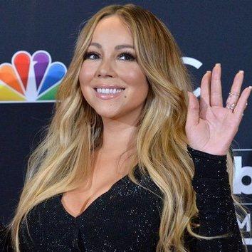 Mariah Carey gana por partida doble